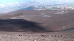 Terrain vehicles & Tourists on the long way to the crater area of Mount Etna Stock Footage