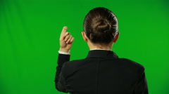 Woman is knocking on a green screen.FULL HD - stock footage