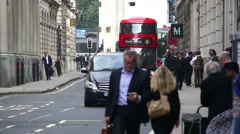 London street scene with red bus approaching Stock Footage