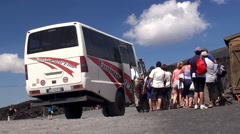 Group of tourists getting on the terrain vehicle to the crater area Stock Footage