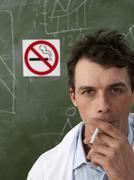 Scientist Smoking near No Smoking Sign Stock Photos