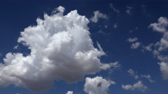 4K Puffy Clouds Explode Spread Across Blue Sky Time Lapse Stock Footage