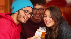 Young people, phone and beer Stock Footage