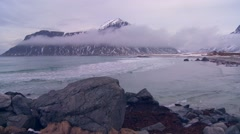 A beautiful foggy snow covered shoreline amidst fjords north of the Arctic Stock Footage