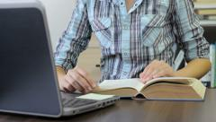 College student studying hard, searching the information in a book Stock Footage