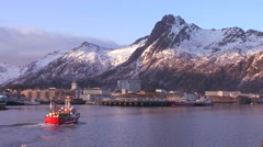 A fishing boat arrives at Svolvaer, the capital city of the Lofoten islands, Stock Footage