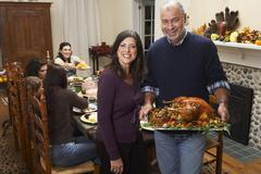 Couple with Thanksgiving Turkey Stock Photos
