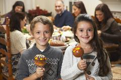 Kids with Caramel Apples at Thanksgiving Dinner Stock Photos