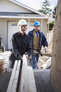 Construction Workers Building Addition on Home Stock Photos