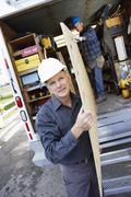 Construction Workers Building Addition on Home - stock photo