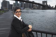 Businesswoman by Brooklyn Bridge, New York City, New York, USA - stock photo