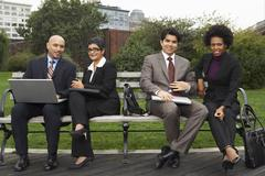 Business People on Park Bench, New York City, New York, USA Stock Photos