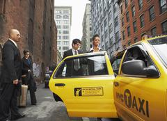 Business People Sharing Taxi Cab, New York City, New York, USA - stock photo