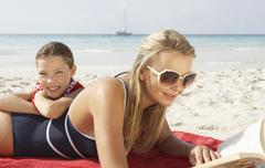 Mother and Daughter on Beach, Majorca, Spain - stock photo