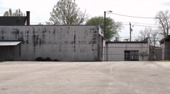 Back Lot of white building Stock Footage
