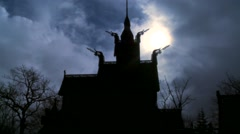 The sun shines behind a spooky stave church in Norway; Stock Footage