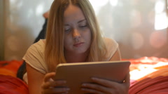 Beautiful woman finds surprising content on tablet Stock Footage