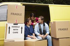 Family with Van and Moving Boxes Stock Photos