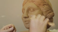 Sculptor Corrects Arm Of Female Figurine By Special Tool - stock footage