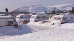 Campers are buried in a trailer park in deep snow. - stock footage