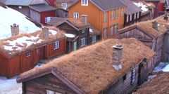 Thatch roofed wooden buildings line the streets of the old historic mining town Stock Footage
