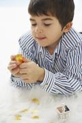 Close-up of Boy Playing with Dreidel - stock photo