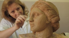 Woman Modelling in Clay - stock footage