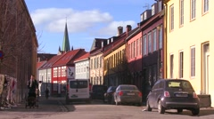 Colorful wooden buildings line the streets of Trondheim, Norway. Stock Footage