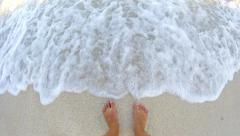 4k summer concept, foot in the sea while waves splash and make legs wet. warm Stock Footage