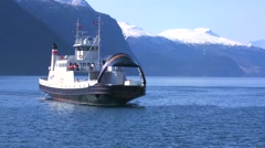 A ferry boat crosses the fjords of Norway. - stock footage