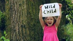 Little Girl Holds Up A Paper Sign With The Words Cut Out, She Growls Like Animal Stock Footage