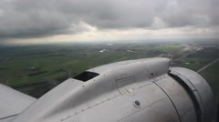Wing and engine of a DC-3 Dakota during flight Stock Footage