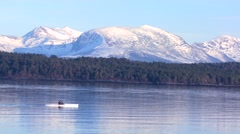 A kayak travels across a fjord near the town of Molde, Norway. Stock Footage