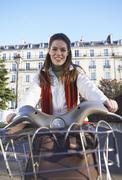 Woman Renting Bicycle, Paris, France - stock photo