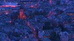 Zoom out from a high angle view at dusk over town of Alesund, Norway. Stock Footage
