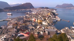 A high angle view over the town of Alesund, Norway with the Hurtigruten cruise Stock Footage