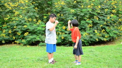 Child playing rock paper or scissors Stock Footage