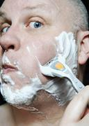Man Shaving Stock Photos