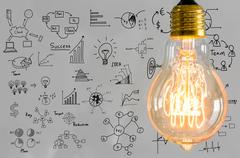 Stock Illustration of light bulb with drawing graph