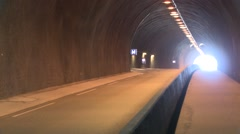 The entrance to a long and deep tunnel through a mountain. Stock Footage