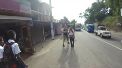 Man carrying little blond girl on his shoulders while walks down the street. - stock footage