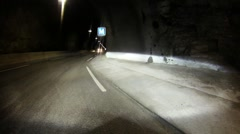 POV shot of a car traveling through a single lane tunnel through a mountain. Stock Footage
