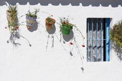 Stock Photo of Hanging Pots on Wall, Andalucia, Spain