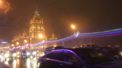 Russia, Moscow, night cityscape, traffic on Kutuzov avenue by hotel Ukraine. Stock Footage