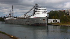 A lake freighter moves through the Welland Canal - stock footage