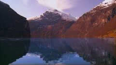 Beautiful wide shot of the fjords of Norway reflecting mountains. Stock Footage