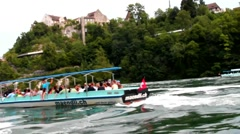 Tourists on the boat floating to Rhine Falls Stock Footage