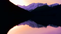 A perfect reflection in a mountain lake at sunset. Stock Footage