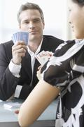 Business People Playing Poker Stock Photos