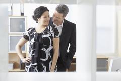 Businesswoman and Businessman Flirting Stock Photos
